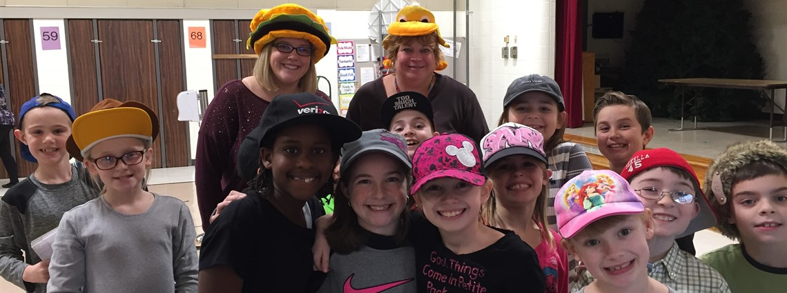 Nurse Green and Miss Ivey celebrate Hat Day along site students at Richmond Elementary!